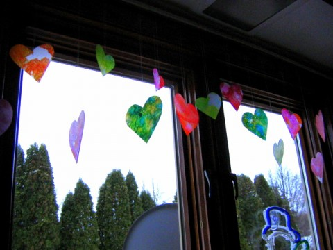 Heart decorations hanging from window