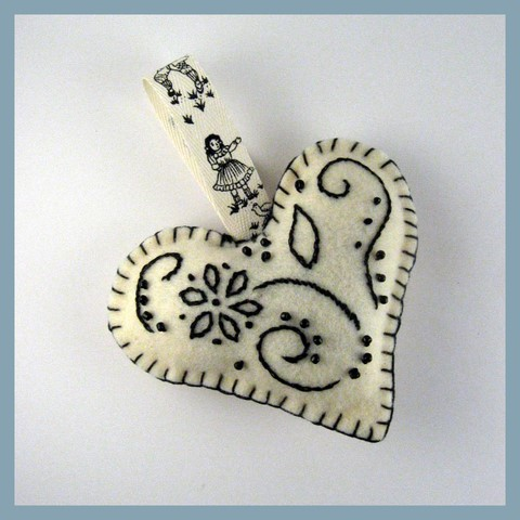 Black and cream stitched heart