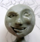 Sculpted face and sketch for boy sculpture
