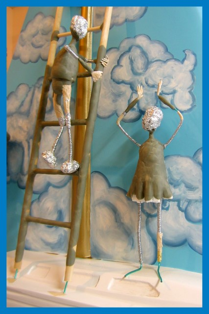 Ladder boy and paint girl sculpture