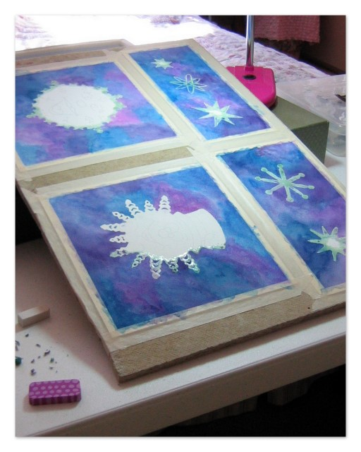 Snowflake designs at Christine's work table
