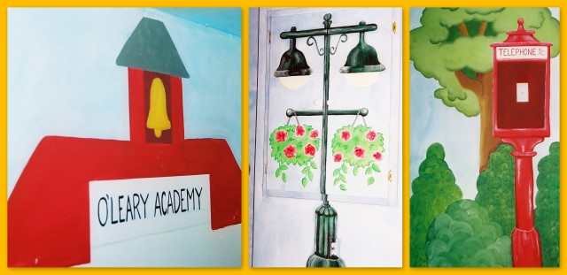 Schoolhouse, street lamp and telephone booth wall mural