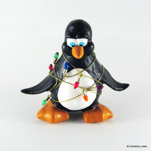 Penguin sculpture wrapped in Christmas lights