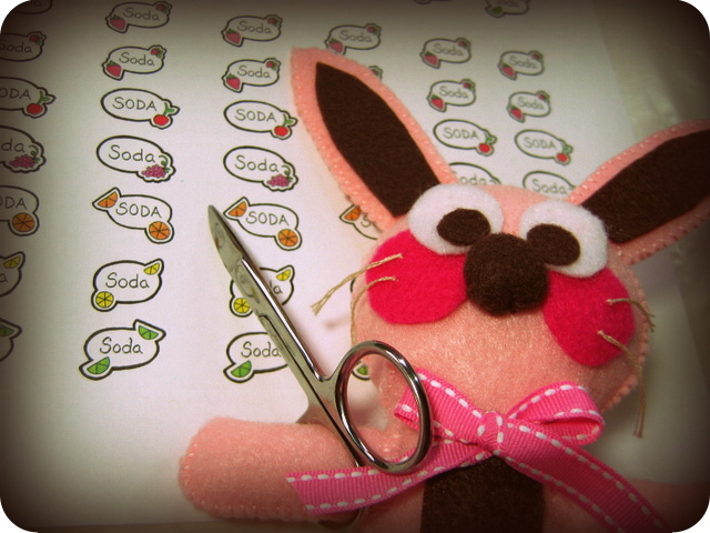 Ralphie the bunny with mini scissors and labels for soda cans