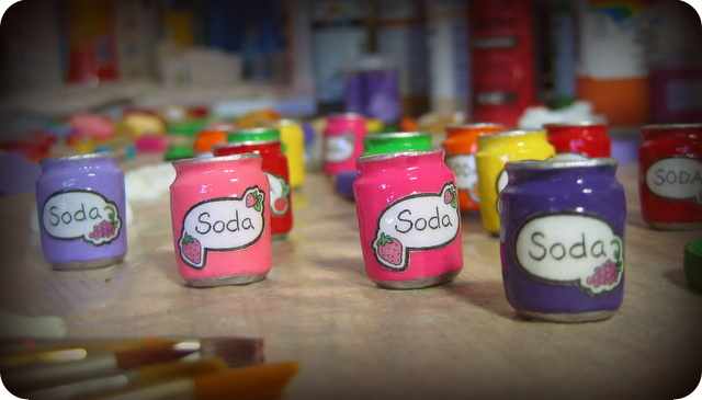 Mini soda cans in the painting and glazing studio