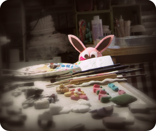 Ralphie peeking from behind the resin pieces