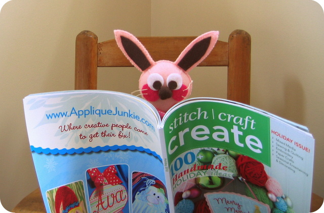 Ralphie looking at glitter ornaments article in Stitch Craft Create magazine article