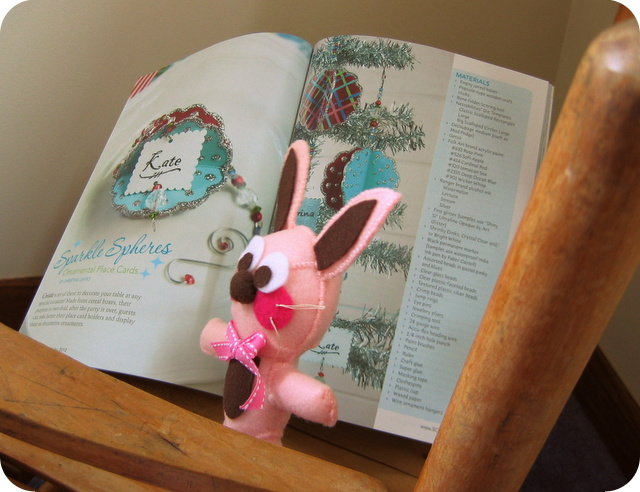 Ralphie with Holiday 2012 issue of Stitch Craft Creat to read glitter oranmetn article