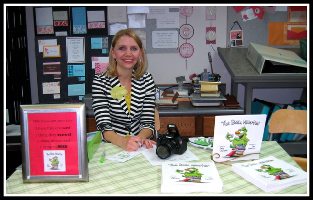 "Emily Waisanen at her book signing table at the ""Tour the Town"" Art Walk"